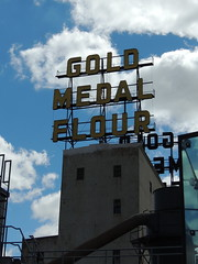 Gold Medal Flour (Anita363) Tags: sky mill minnesota sign clouds minneapolis cumulus mn goldmedalflour nationalhistoriclandmark washburnamill millcitymuseum nationalregisterofhistoricplaces cumulushumilis
