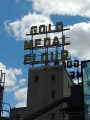 Gold Medal Flour (Anita363) Tags: sky mill minnesota sign clouds minneapolis cumulus mn goldmedalflour nationalhistoriclandmark washburnamill millcitymuseum nationalregisterofhistoricplaces cumulushumilis