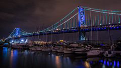 Ben Franklin Blues (PhillymanPete) Tags: city longexposure bridge blue urban philadelphia water architecture night clouds reflections river boats lights us nikon unitedstates pennsylvania police honor nighttime philly benfranklinbridge brotherlylove d7200