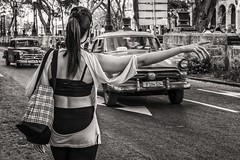 trying to catch a cab (Gerard Koopen) Tags: cuba havana habana bw blackandwhite straatfotografie streetphotography straat street candid oldmobile oldcar taxi cab tryingtocatchacab woman girl fujifilm fuji xpro1 35mm 2016 gerardkoopen