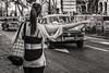 trying to catch a cab (Gerard Koopen) Tags: cuba havana habana city bw blackandwhite straatfotografie streetphotography straat street candid oldmobile oldcar taxi cab tryingtocatchacab woman girl fujifilm fuji xpro1 35mm 2016 gerardkoopen