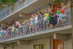 balcony (stevefge) Tags: nederland netherlands nijmegen nederlandvandaag people candid watchers girls vierdaagse street balcony balkon reflectyourworld baloons party