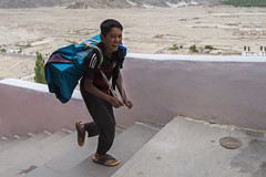 Cheerful Kid (Ravikanth K) Tags: 500px cheerful kid thiksey monastery leh ladakh gompa india jammuandkashmir travel action motion smile boy steps running climbing books carrying