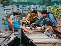 Sharing a meal (Maren 86) Tags: vietnam asia travel women boat boats meal food lumixg7 river water microfourthirds