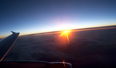 hallo light! (Pixeled79) Tags: voyage trip blue light red sky orange sun reflection window clouds sunrise upload dark photography fly europe flickr glare horizon flight over wing engine human cycle plates universe pixeled79