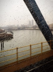 En route (LookingUpPhotography) Tags: nyc newyorkcity bridge en apple window rain train river droplets blurry tracks route bigapple metronorth iphone