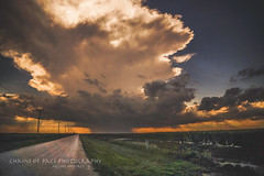 Watching it Come (Chains of Pace) Tags: road sunset storm oklahoma rural landscape perspective retro prairie panhandle guymon