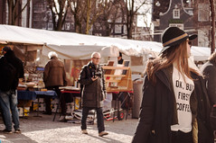He's behind you... (sawyersource) Tags: street people coffee amsterdam nikon photographer market streetphotography tshirt sunny books follow 1855mm tshirts voyer spui d5000