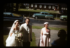 ms 1943-54 AB-140 (ndpa / s. lundeen, archivist) Tags: street flowers wedding people woman man color cars film 35mm groom glasses bride women veil dress nick bowtie 1954 slide tuxedo 1950s bouquet kodachrome gown eyeglasses tux youngwoman parkedcars automobiles 1953 dewolf bridalgown whitetuxedo nickdewolf photographbynickdewolf ellisonwedding hankellison aitchellison locationunidentified eliison hankellisonwedding