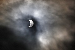 Solar eclipse (Monchichila) Tags: sky sun moon nature clouds eclipse getty heavenly bodies gettyimages solareclipse