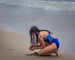 Sand Treasures (Mildred Alpern) Tags: girl sand beach waves search outdoors