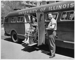 Polio Girl uses bus lift - 1940s (jackcast2015) Tags: polio infantileparalysis poliomylitis braces braced calipers handicapped disabledwoman crippledwoman wheelchair