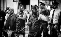 A Boxer? (Just Ard) Tags: man leather pride cardiff mask gloves lead people person face street photography candid unposed black white mono monochrome bw blackandwhite noiretblanc biancoenero schwarzundweis zwartwit blancoynegro  justard nikon d750 50mm