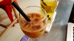 East meets west (Roving I) Tags: tradition innovation milkcoffee alcoholicdrinks wine cafes cabanon danang vietnam stemware coldtea icecubes