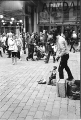 A man and his puppet (Stuart Grout) Tags: bwfp leica m2 ilford hp5 manchester film street puppet