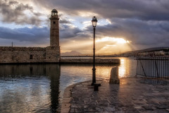 Sunrise (Theophilos) Tags: old sea sky lighthouse clouds sunrise harbour crete venetian rethymno