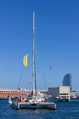 Port Vell Catamaran (NykO18) Tags: ocean barcelona sea people españa haven water ferry sailboat person harbor boat spain europe ship yacht catalonia transportation manmade vehicle catalunya cataluña mediterraneansea funicular ferryboat cablerailway shuttleboat naturalelement portvelldebarcelona hotelwbarcelona