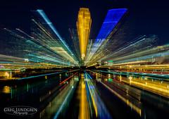 Skyline Eruption (Greg Lundgren Photography) Tags: light urban abstract color reflection skyline night cityscape zoom minneapolis mississippiriver twincities greglundgren onlyinmn