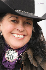 Beautiful Cowgirl Smiles (wyojones) Tags: woman cute girl beautiful beauty smile pretty coat houston parade greeneyes cowgirl brunette houstonlivestockshowandrodeo neckerchief cowgirlhat trailrider neckerchiefslide wyojones houstonlivestockshowandrodeoparade valleylodgetrailrideassociation
