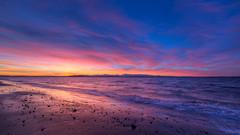 Finally Free (John Westrock) Tags: sunset clouds sky elliotbay pugetsound water shore reflection pacificnorthwest westseattle seattle canoneos5dmarkiii samyang14mmf28ifedmcaspherical wideangle johnwestrock pwlandscape washington