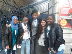 Journey to Justice group outside the Garrick Theatre with members of the cast