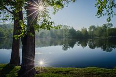 241 (Tom Manary) Tags: morning summer sun lake reflection water sunrise reflections missouri sunburst branson laketaneycomo
