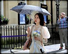 Elegance (* RICHARD M (7.5 MILLION VIEWS)) Tags: street candid portraits portraiture streetportraits streetportraiture candidportraits candidportraiture elegance elegant beauty beautifulgirl prettygirl japanese japanesegirl japanesebeauty japaneselady parasol silkdress style stylish femininity feminine personalgrooming fashion jenesaisquoi bath cityofbath somerset class classy ladylike boquet flowerboquet floralboquet brolly umbrella easternbeauty summer summertime june railings ironrailings shoulderbags purse petite dainty pretty beautiful gorgeous gorgeousgirl refined refinement tasteful almondeyes ribbons