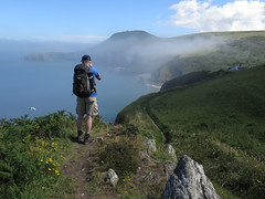 Mox on the Ceredigion coastal path. (julesbondy) Tags: sea sand coast wales coastal path mist haar cliff clouds blue sky