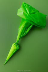 Green pastry bag. (annick vanderschelden) Tags: pastry pastrybag green greenbackground cream filled pipingbag triangularshaped plastic pipe semisolid foods press pressing opening narrow cake disposable kitchen food cuisine gastronomy decoration twisted rolled squeeze extrude contents whippedcream belgium