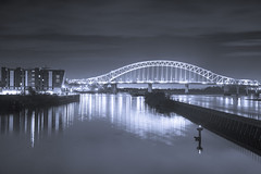 Runcorn Bridge (Elysian-Photography) Tags: uk longexposure bridge trees england seascape reflection water monochrome leaves architecture night lights blackwhite sand arch cheshire northwest towers steam gas nighttime naturereserve infrastructure coal waterscape runcorn widnes coolingtowers biomass lighttrail halton longshutterspeed manchestershipcanal rivermersey runcornbridge silverjubileebridge northwestengland fiddlersferrypowerstation wiggisland motthayandanderson runcorngap cuerdley unusualviewsperspectives
