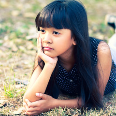 Little cute girl laying on the ground, (Patrick Foto ;)) Tags: park summer portrait people white cute nature girl beautiful beauty female garden season asian fun outside spring hands pretty looking little sweet outdoor head background young thoughtful lifestyle thai thinking attractive concept copyspace lovely laying