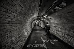 The Writing's On The.........Floor! (www.paulshearsphotography.com) Tags: people urban bw london monochrome bike canon dark underpass underground person iso800 lights mono vanishingpoint blackwhite cyclist tunnel journey f56 16mm rider grimey nocycling greenwichfoottunnel canonef1635mmf4lisusm 125second thewritingsonthefloor canoneos5dmarkiii eos5dmarkiii 5dmarkiii ef1635mmf4lisusm