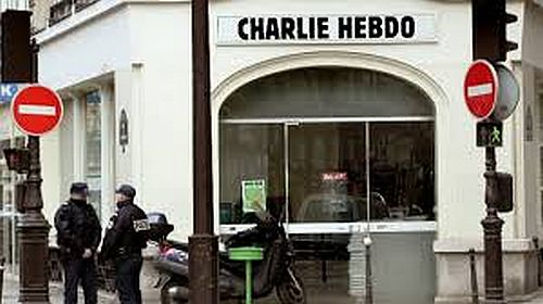 Charlie Hebdo puts Mohammed on its new cover