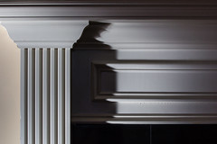 Shadows and light; white and black (tarboxje) Tags: shadow white black line column parallellines sidelight shadowpattern fireplacesurround