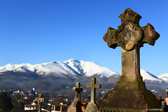 Tiny town in southwest of France (Fanorosa) Tags: travel snow france church cemetery canon eos bokeh churchyard moutain voyages eos600