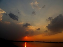 The Sun surrounded by clouds !! (rick_toor) Tags: winter sky lake reflection nature water beautiful rain clouds lens photography lights flickr colours sony hobby chandigarh sukhnalake naturephotography sukhnalakechandigarh sonydschx400v ricktoor