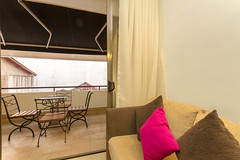 Living area overlooking the balcony (T and V Boutique Apartments) Tags: vacation court hospital apartment budget central rental sri lanka national ceylon accommodation spa colombo groups fully hedges serviced hayleys odel asiri