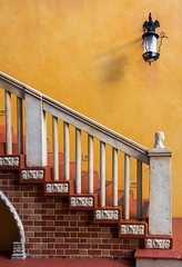 Colors of Italy (Kaylee Brendel) Tags: light red summer italy orange sun color building brick art texture crimson yellow coral architecture stairs composition contrast canon scarlet gold amber orlando epcot movement angle bright florida outdoor steps vivid wideangle disney line disneyworld blond saturation copper capture themepark russet worldshowcase