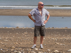 At the beach. (CWhatPhotos) Tags: cwhatphotos convers shoe chucks brown leather all star camera photographs photograph pics pictures pic picture image images foto fotos photography artistic that have which contain olympus em10 mk ii beach horden peterlee coast coastal sea pebbles pose portrait man male tattooed tattoos tattoo atthe shore line shoreline water
