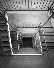 Black hole. (christiannass) Tags: explore iphone iphoneography deutschland photography inspired inspiring exploring germany mobile camera flickr traveling white vanishingpoint monochrome staircase building bw stairs architecture black symmetry blackwhite