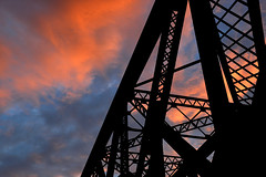 Railroad Bridge Sunset (dr_marvel) Tags: sunset railroad bridge pittsford ny orange red evening water clouds rochester erie canal eriecanal girders black trains