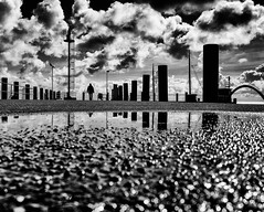 On the Edge (Dan-Schneider) Tags: blackandwhite bw schwarzweiss street streetphotography schneider scene silhouette sky sea camera clouds decisive moment mft monochrome mirror mood olympus omdem10 human photography people prime lens light man puddle puddlegram europe trip travel reflection einfarbig