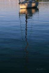 Morning reflections (astrogirl969) Tags: fujifilmxf1855f284r morning dawn colour contrast water blue orange balmaineast iwps boat reflection ripple shadow sailboat fujifilm postprocessed nikcolorefex4 1000views xe1