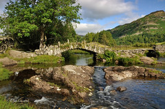 Where Footsteps Linger On (jeanette_lea) Tags: slaters bridge the lake district cumbria water stones trees reflections sky clouds