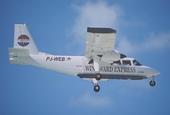 283cd - Windward Express Airways Britten-Norman BN-2A-21 Islander; PJ-WEB@SXM;05.03.2004 (Aero Icarus) Tags: slidescan plane avion aircraft flugzeug princessjulianainternationalairport mahobeach saintmartin sxm
