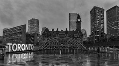 Toronto in the Rain (superdavebrem77) Tags: panorama blackandwhite rainyday toronto courthouse oldcityhall nathanphillipssquare