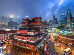 Raikou (Scintt) Tags: singapore chinatown tourism travel temple buddha tooth oriental religious chinese asian attractions iconic building architecture structure evening light night glow long exposure lightning dramatic epic surreal strike thunder thunderbolt electricity trails cityscape city skyline skyscrapers cbd central business district financial centre tanjong pagar offices shophouses vantage point wide angle irix 15mm f24 lens blue colours sky clouds rain thunderstorm storm weather nature power cumulus scintillation scintt jon chiang photography stormy foggy plasma bolt