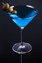 Martini (Tom Whitney Photography) Tags: martini vermouth vertical blue olives crystal glass black refreshing smooth gin vodka drink pimento stuffed
