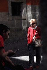 Toledo, 2016 (A-cat-and-a-half) Tags: woman red toledo street sun shadow candid spain contrasts people child age juxtaposition karinater