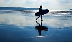 Lone Surfer II (DawnWarrior) Tags: surf surfer bodyboard shallow water reflection running wetsuit worms head rhossili gower tide tidal clouds headland landscape sonyrx10 dawnwarrior silhouette llangennith